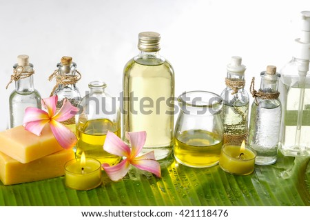 health spa with soap,candle, orchid and banana leaf - stock photo