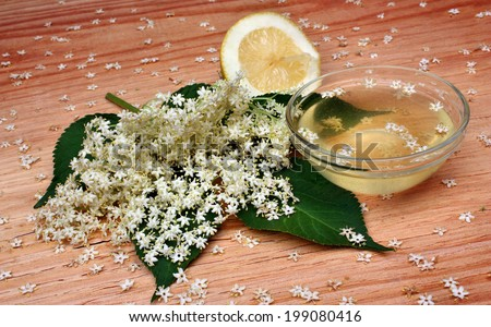 Health syrup  from elderberry flowers  on a wooden table - stock photo