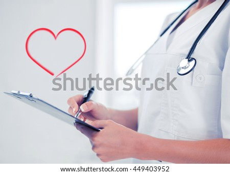 healthcare and medical concept - female doctor with stethoscope writing prescription - stock photo