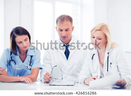 healthcare and medical concept - team or group of doctors on meeting