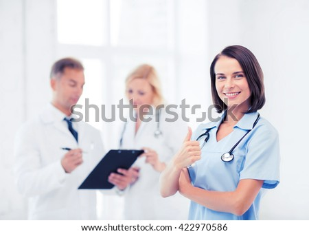 healthcare and medical concept - young female doctor with stethoscope - stock photo
