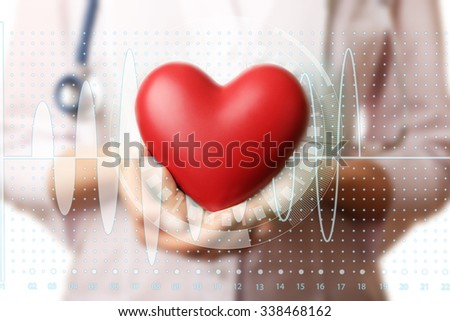 Healthcare and medicine concept. Doctor hands with heart and stethoscope - stock photo