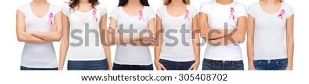 healthcare and medicine concept - group of smiling women in blank t-shirts with pink breast cancer awareness ribbons - stock photo