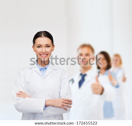 healthcare and medicine concept - smiling female doctor - stock photo
