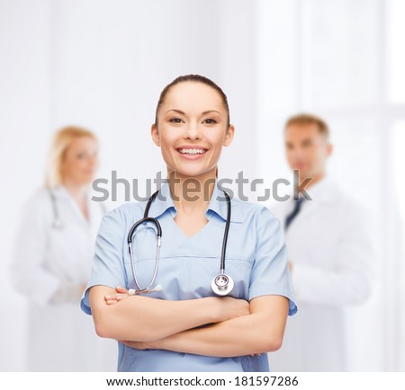 healthcare and medicine concept - smiling female doctor or nurse with stethoscope