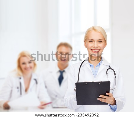 healthcare and medicine concept - smiling female doctor with stethoscope and clipboard - stock photo