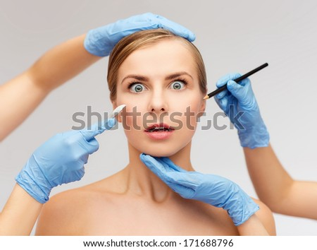 healthcare, beauty and medicine concept - beautiful woman face and beautician hands with pencil and scalpel - stock photo