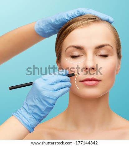 healthcare, beauty and medicine concept - beautiful woman face with closed eyes and beautician hands with pencil - stock photo