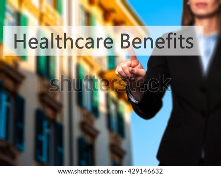 Healthcare Benefits - Businesswoman hand pressing button on touch screen interface. Business, technology, internet concept. Stock Photo - stock photo