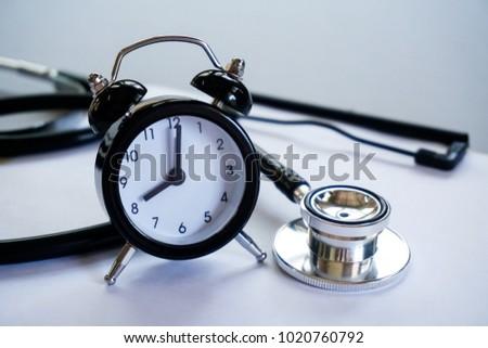 healthcare concept alarm clock stethoscope on stock photo royalty