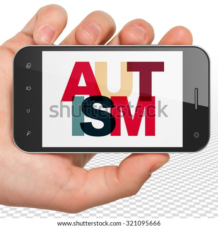 Healthcare concept: Hand Holding Smartphone with Painted multicolor text Autism on display - stock photo