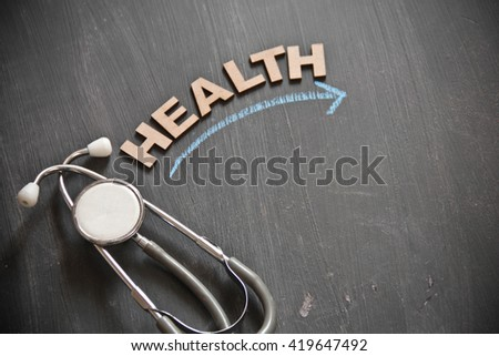 "Healthcare concept. ""Health Benefit"" design with chalk on a black board with stethoscope. - stock photo"