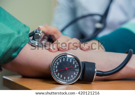 healthcare, hospital medicine concept - doctor and patient measuring blood pressure - stock photo