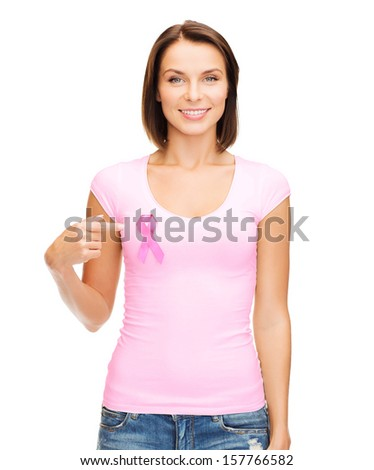 healthcare, medicine and breast cancer concept - woman in blank t-shirt with pink cancer ribbon - stock photo