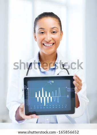 healthcare, medicine and technology concept - african female doctor with tablet pc - stock photo