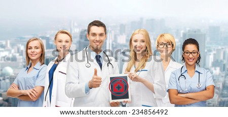 healthcare, medicine and technology concept - group of young doctors with tablet pc computer - stock photo