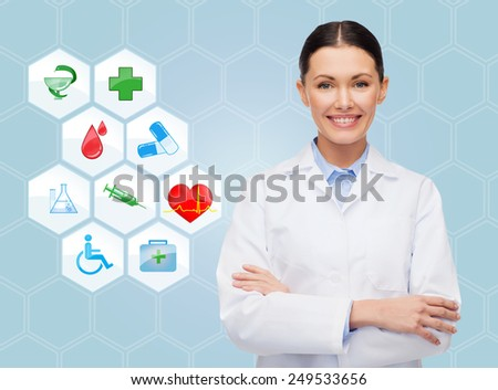 healthcare, medicine, people and symbols concept - smiling young doctor or nurse over medical icons and blue background - stock photo