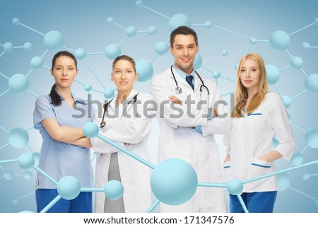 healthcare, research, science, chemistry and medicine concept - young team or group of doctors - stock photo