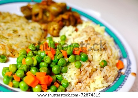 Healthy and balanced diet of seasoned fried rice, colorful peas and other ingredients. - stock photo