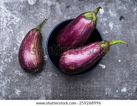 Healthy and delicious purple eggplants on vintage background