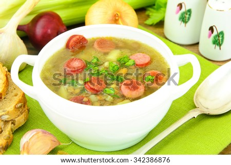 Healthy and Diet Food: Soup with Lentils and Sausage. Studio Photo