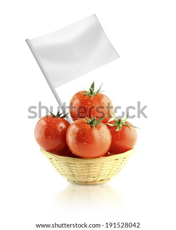 Healthy and organic food concept. Fresh Tomatoes in Dish straw with flag showing the benefits or the price of fruits. - stock photo