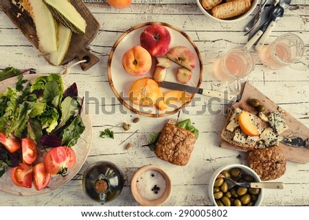 Healthy and vegetarian food background from above. Toned image - stock photo