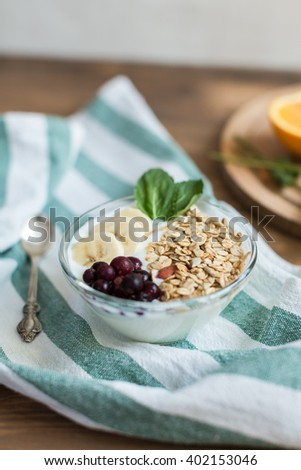 Healthy and wholesome breakfast. Yogur with muesli and currants - stock photo