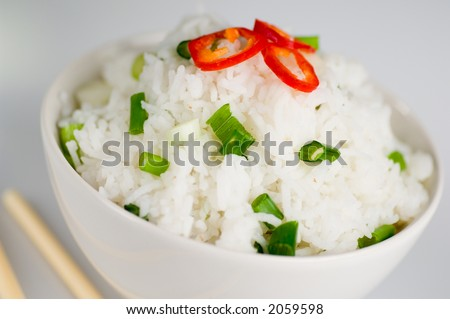 Healthy asian rice dish and chopsticks