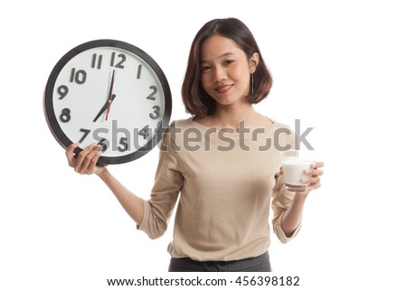 Healthy Asian woman drinking  glass of milk hold clock  isolated on white background - stock photo