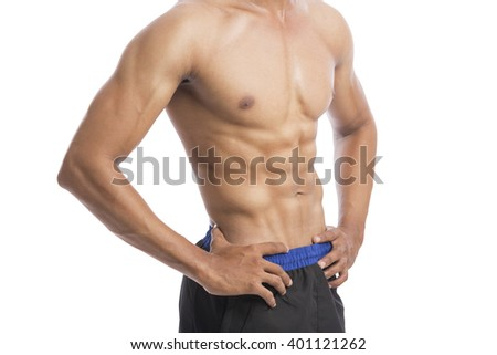healthy athletic young man showing muscle isolated on white.