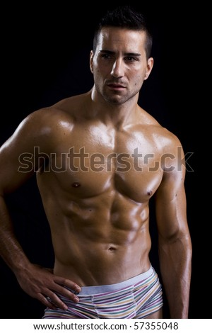 healthy attractive guy showing his strong and fit torso - stock photo