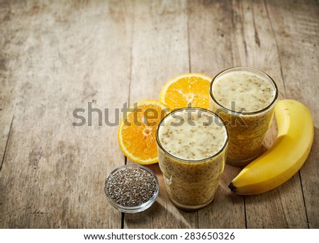Healthy banana and orange juice smoothie with chia seeds - stock photo