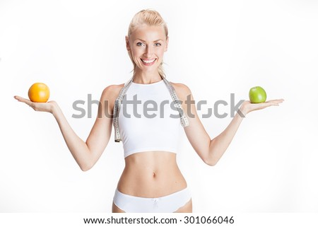 Healthy beautiful blonde woman holding fruits, smiling. Healthy fitness and eating lifestyle concept. Happy girl on diet.