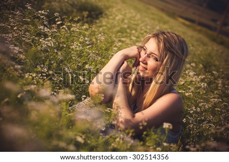 Healthy beautiful woman walking outdoors. Alluring young woman in wheat field, delicate sensual woman on nature. perfect skin, curly hair. - stock photo