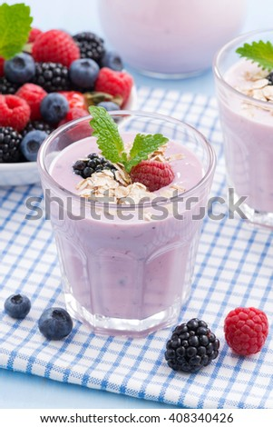 healthy berry smoothies with oatmeal, close-up, vertical - stock photo