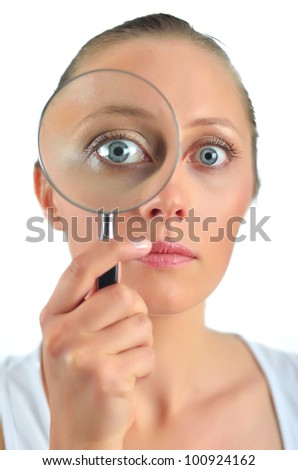 Healthy blondy happy woman looking with a magnifying glass - stock photo