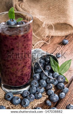 Healthy Blueberry Shake on wooden background - stock photo