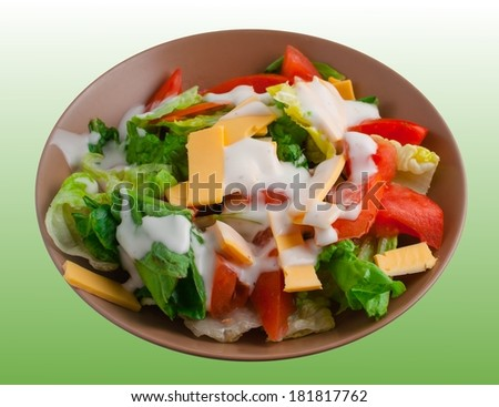 Healthy bowl of salad on green background