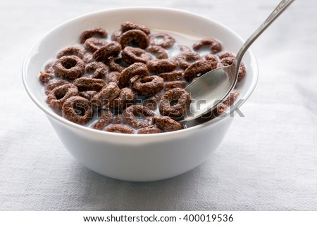 Healthy breakfast - cereal rings in a white bowl with milk
