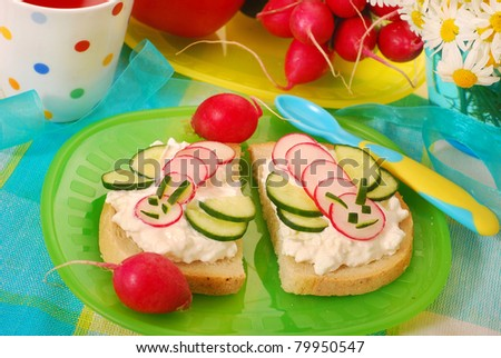 healthy breakfast for child with cottage cheese,radish and cucumber in bee shape - stock photo
