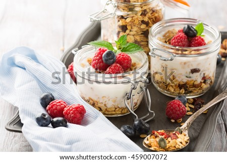 Healthy breakfast - Fresh homemade granola, berries and y yogurt in a ...