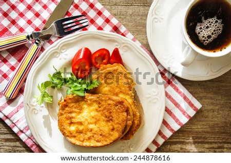 Healthy breakfast, fresh vegetables with bread and topping cream - stock photo