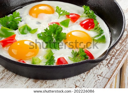 Healthy breakfast - fried eggs and vegetables . Selective focus