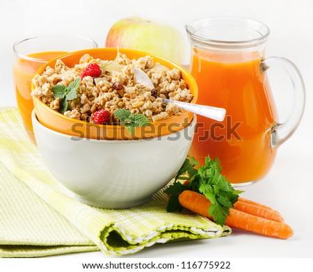 Healthy breakfast - muesli and Carrot juice - stock photo