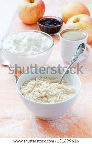 healthy breakfast: oatmeal, cottage cheese, coffee, fruits