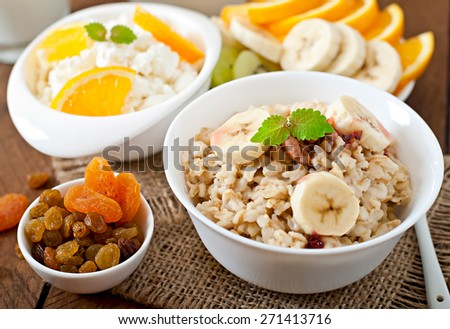 Healthy breakfast - oatmeal, cottage cheese, milk and fruit - stock photo