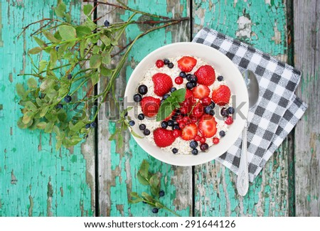healthy breakfast, oatmeal, strawberries and blueberries - stock photo