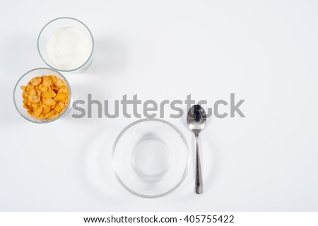 healthy breakfast of cornflakes and yogurt / fit breakfast - stock photo