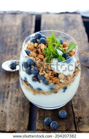 Healthy Breakfast of Granola cereal berries and yogurt  - stock photo